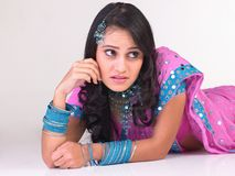 Indian girl in a thinking expression Royalty Free Stock Photo