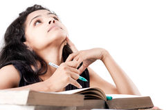 Indian Girl tired and exhausted with old books Royalty Free Stock Images