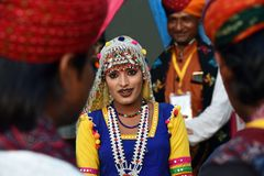 Indian girl in traditional Rajasthani dress. Gandhinagar, India - February 26, 2018 : Indian girl wearing traditional Rajasthani dress participate in annual Stock Photo