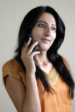 Indian girl using mobile phone Royalty Free Stock Image