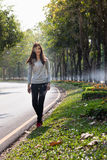 Indian girl walking in the park. Royalty Free Stock Image