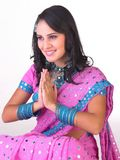 Indian girl in a welcome posture Royalty Free Stock Image