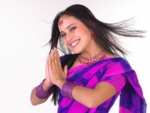 Indian girl in a welcome posture Royalty Free Stock Images