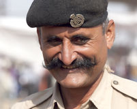 Portrait of a police officer on the Pushkar fair  Stock Photo