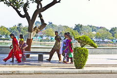 Indian girls. FEB 07, 2015, AHMEDABAD, INDIA - Group of Indian girls dressed in shalwar-kamiz walking on the embankment of Kankariya lake Stock Images
