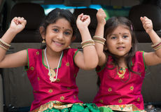 Indian girls sitting in car. Happy Indian girls sitting in car smiling, ready to vacation. Asian children royalty free stock photography