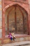 Indian girls sitting at Humayun's Tomb gate, Delhi, India Stock Image