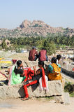 Indian girls sitting outside of a temple at Hampi Royalty Free Stock Image