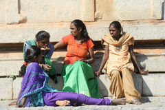 Indian girls sitting outside of a temple at Hampi Royalty Free Stock Photos
