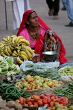 Indian girlselling fruits and vegetables Royalty Free Stock Photography