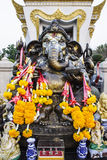 The Indian God, elephant - headed god. The Indian God Ganesha made from clay in low relief carving jig saw image style Stock Photo