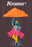 Indian God Krishna lifting mountain Royalty Free Stock Image