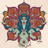 Indian goddess Kali with two snakes on traditional mandala round pattern Royalty Free Stock Image