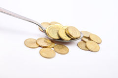 Indian Gold Coin with Silver Spoon Royalty Free Stock Images