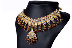 Indian Gold Necklace. Indian Gold Traditional Necklace with Red Beads Stock Photography