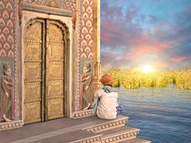 Indian golden door. Man near a traditional indian door in the sunrise Royalty Free Stock Image