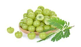 Indian gooseberry in wood bowl on white background.  stock photography
