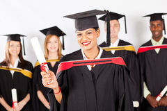Indian graduate with classmates Stock Photo