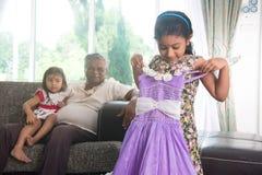 Indian grand daugther trying out diawli dress Stock Photos