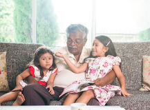Indian grandfather learning Royalty Free Stock Image