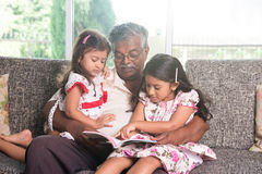 Indian grandfather learning stock photography