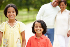 Indian Grandparents And Grandchildren Walking In Countryside. Close Up Of Indian Grandparents And Grandchildren Walking In Countryside Looking To Camera Smiling Stock Photography