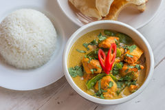 Indian green curry with basmati rice and papadums. Indian green curry with chicken, basmati rice and papadums Royalty Free Stock Photography