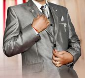 Indian groom getting his suit royalty free stock photo