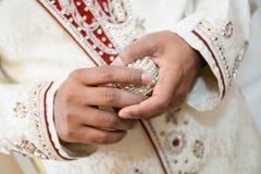 Indian groom holding ring. Indian groom holding box containing wedding rings Stock Photos