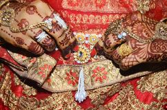 An Indian groom showing her golden belly belt attached above saree expended closeup shot stock photography