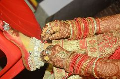 A Indian groom dulhan showing her payal closeup beautiful shot stock images