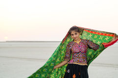 Indian Gujarati young village girl. Indian young Gujarati village girl wearing colorful embroidery costume stock photo
