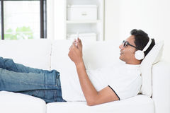 Indian guy enjoying music Royalty Free Stock Image