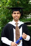 Indian guy in a graduation gown. Royalty Free Stock Photos