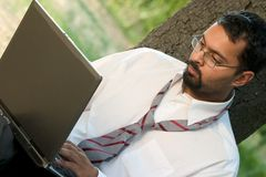 Indian guy with laptop. Young Indian man with laptop Stock Photos