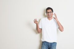 Indian guy listening music Stock Photos