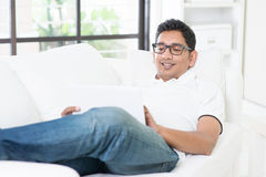 Indian guy using digital computer tablet Royalty Free Stock Images