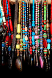 Indian handicrafts of colorful beads. Against black background Stock Photos