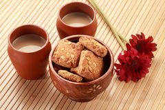 Indian Handmade Pottery Tea Glasses with Biscuits Stock Image