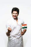Indian handsome boy or man in white ethnic wear holding indian national flag and showing patriotism, standing isolated over white. Background Royalty Free Stock Photos