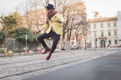 Indian handsome man jumping in the city streets Stock Images