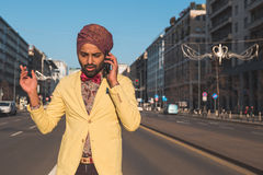 Indian handsome man talking on phone Stock Photos