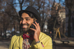 Indian handsome man talking on phone Stock Images