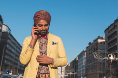 Indian handsome man talking on phone Royalty Free Stock Photos