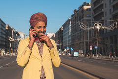 Indian handsome man talking on phone Stock Photography