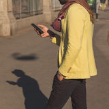 Indian handsome man texting in an urban context Stock Photos