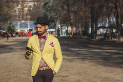 Indian handsome man texting in an urban context Royalty Free Stock Image