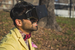 Indian handsome man wearing virtual reality headset Stock Photography