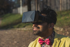 Indian handsome man wearing virtual reality headset Royalty Free Stock Images