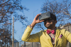Indian handsome man wearing virtual reality headset Stock Image